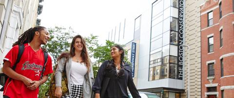 Three students walk by the Boston Conservatory theater