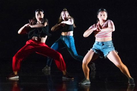 Three dancers on stage.
